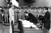 Japan signs surrender document aboard the USS Missouri