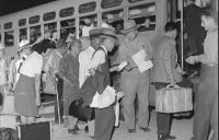 Internees board buses to return home