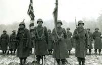 442nd stands review after victory in the Vosges