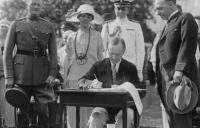 President Coolidge signing the Johnson-Reed Act