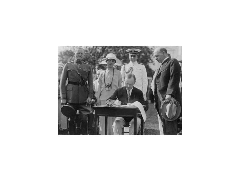 President Coolidge signs the Johnson-Reed Act