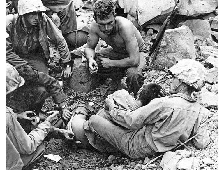 Giving aid to a wounded Japanese soldier