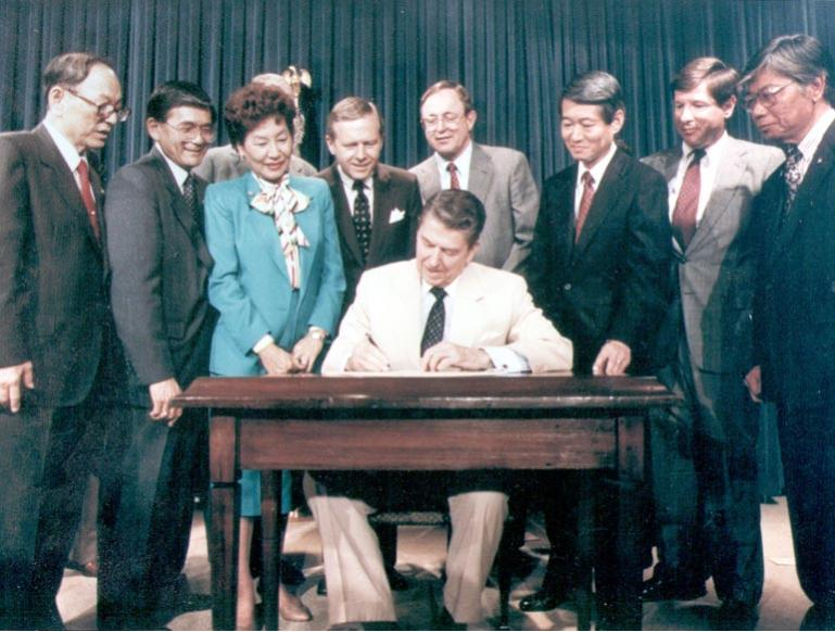 President Reagan signs Civil Liberties Act